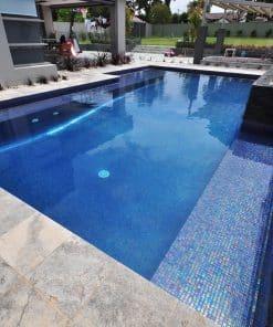 Glass mosaic tile Zafiro by Ezarri. Installed on swimming pool.